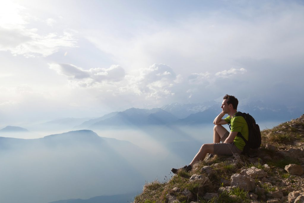 F588E8 traveler enjoying panoramic view during hike, beautiful background with mountain landscape